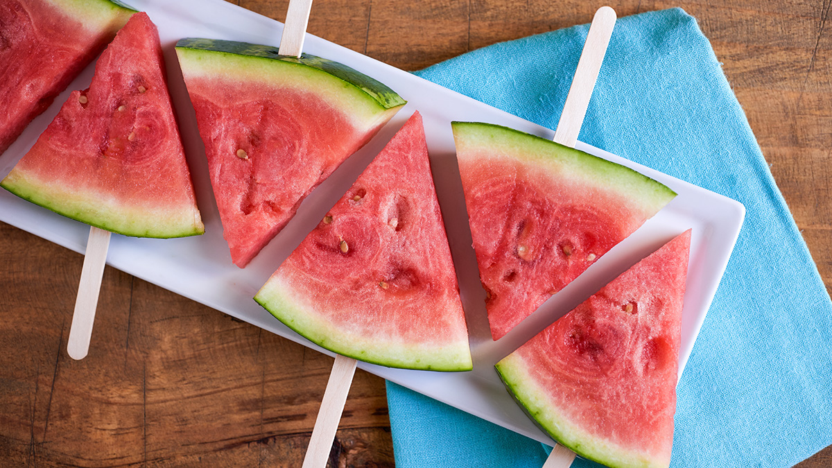 watermelon slices on popsicle sticks